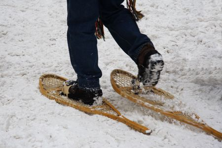 Walking with snowshoes in Quebec, Canada.Motion blur on one shoe. Stock Photo - 4441396