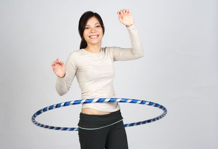 happy girl dooing hula hoop Stock Photo