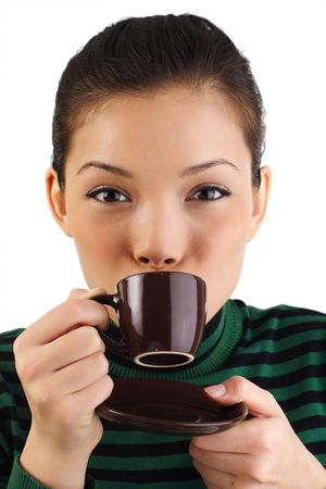 Beautiful young woman drinking espresso photo