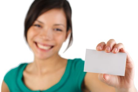 Beautiful young woman with big smile displaying blank business card. Card in focus, model out of focus. Isolated on white. Stock Photo - 4521416