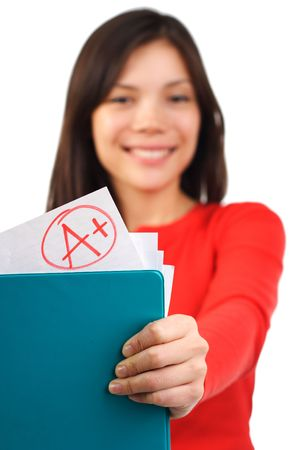 grade: Happy female student showing her top grade. Isolated on white. Stock Photo