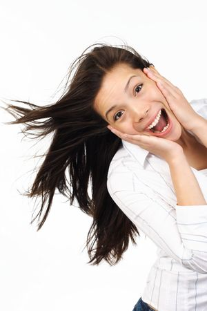 Very happy and surprised eurasian woman holding her head in amazement Stock Photo - 4679519