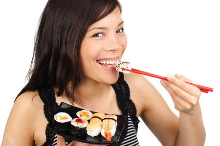 Beautiful young woman laughing while eating sushi. Isolated on white.  photo