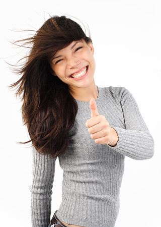 Very excited young mixed caucasian  asian woman giving thumbs up