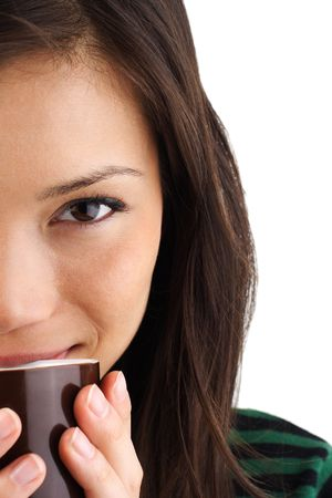 Beautiful mixed asian  caucasian woman drinking coffee or tea Stock Photo