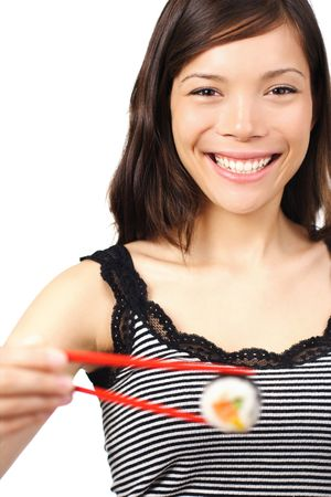 Smiling young woman presenting a maki sushi. Shallow depth of field, focus on eyes. Isolated on white. photo