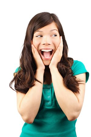 thrilled: Excited young woman looking away in surprise. Isolated on white.