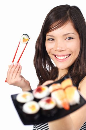Beautiful sushi woman showing a plate of sushi. Shallow depth of field with focus on the eyes. Isolated on white. photo