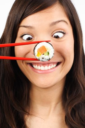 sushi chopsticks: Funny picture of woman with salmon maki sushi