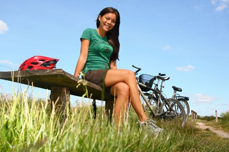 Young woman taking a rest from biking. From the countryside of Jutland, Denmark. Stock Photo - 5084151