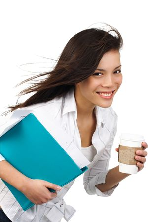 haste: Beautiful casual businesswoman on the move with disposable coffee cup. Isolated on white. Stock Photo