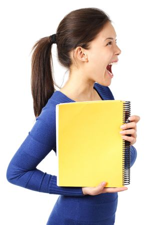 Very excited university student showing blank yellow notebook. Isolated on white. photo
