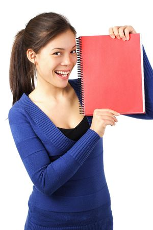 Very happy university student showing blank red notebook. Isolated on white. Stock Photo - 5154057