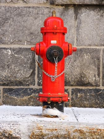 Typical red fire hydrant. Quebec city. photo