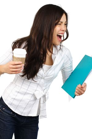 Busy shouting young businesswoman with disposable coffee cup. Isolated on white background. photo