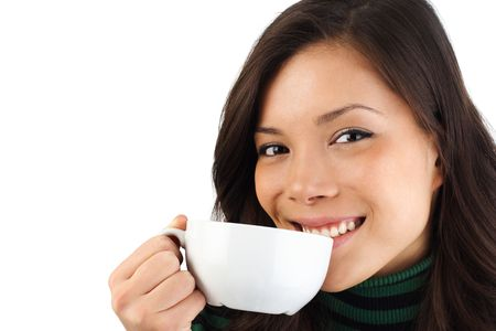 Beautiful young woman enjoying a coffee. Isolated on white background. photo