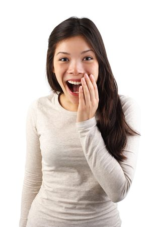excited woman: Happy surprised excited woman holding the hand for her mouth in surprise. Isolated on white background. Stock Photo