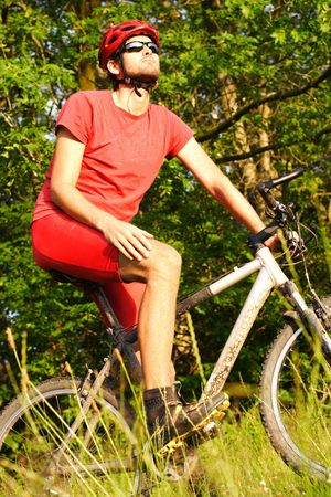 Man taking a break during a mountain bike ride in the forest Stock Photo - 5216243