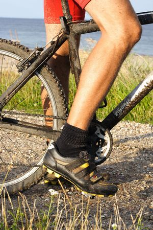 Closeup of mountain bike on dirt track with beach in the background. Stock Photo - 5217388