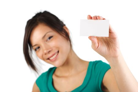 notecard: Beautiful young woman with big smile displaying blank business card. Shallow depth of field, focus on card. Isolated on white background.