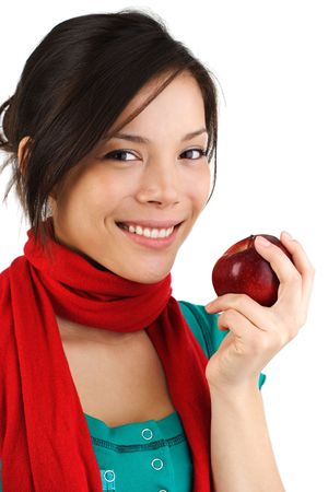 Beautiful autumn woman eating a red apple. Isolated on white background. photo