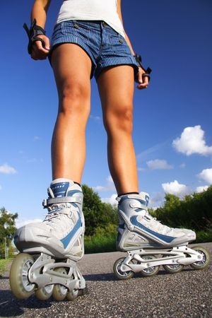 inline skates: Inline skates. closeup of woman legs and skates. Stock Photo