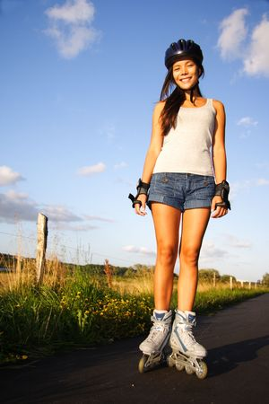 inline skates: Woman on inline skates on a warm sunny evening. From Aarhus, Denmark. Stock Photo