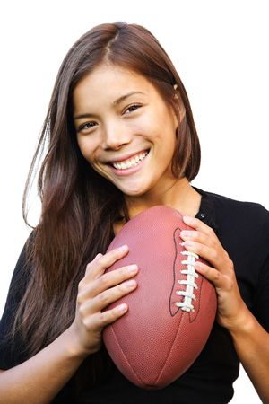 chinese american: Smiling woman holding american football. Isolated on white background.