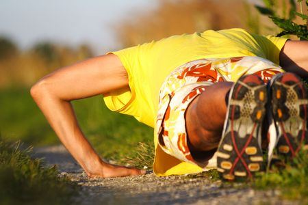 Man doing push-ups during outdoor exercise in summer evening light. Stock Photo - 5317354