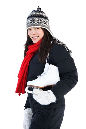 Ice skating. Beautiful woman going ice skating. Isolated on white background. Natural cold light. photo