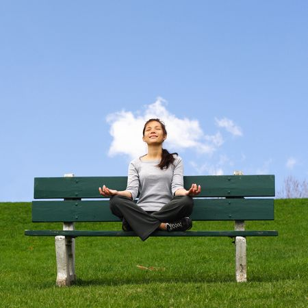 Meditation outside with magic cloud. Beautiful mixed asian / caucasian woman. Stock Photo - 5382477