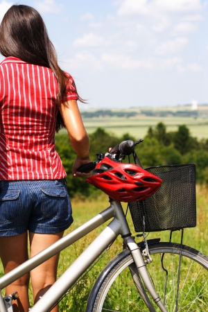 young female enjoying the view after a bike trip in Jutland, Denmark Stock Photo