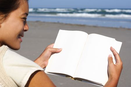 reading woman of book with blank copyspace on the beach. photo
