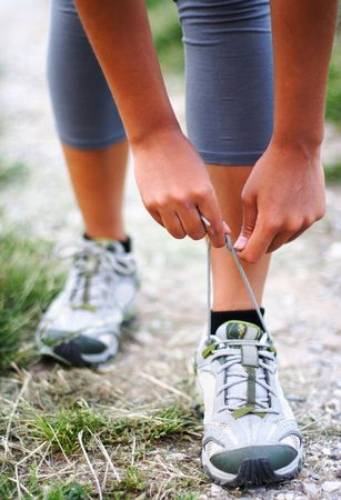 shoe laces: Running shoes being tied by woman getting ready for jogging. Stock Photo
