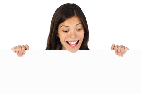 head down: Very excited woman holding billboard  blank sign looking down. Isolated on white backgrund