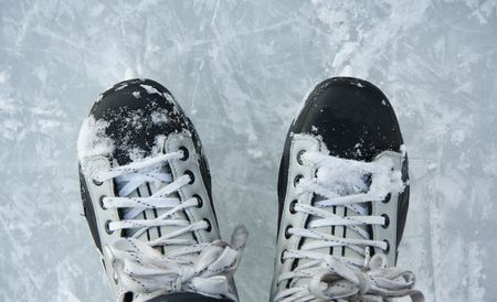 Closeup hockey ice skates in action outdoors. photo