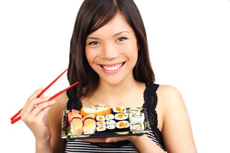 take away: Sushi. Woman eating take away sushi closeup. Beautiful smiling model isolated on white background.