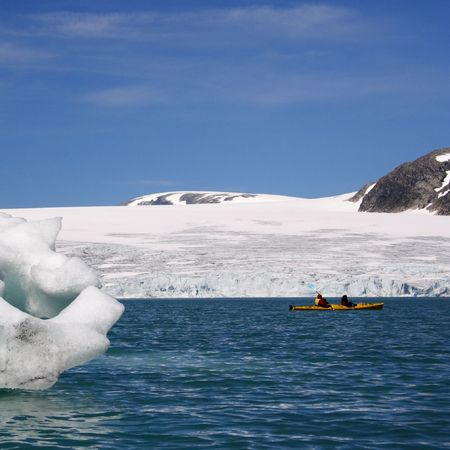 jostedal: Kayak near glacier front and icebergs in Jostedal, Norway Stock Photo