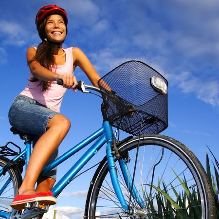 Biking under deep blue sky in the countryside of Jutland, Denmark during summer. Beautiful happy woman. photo