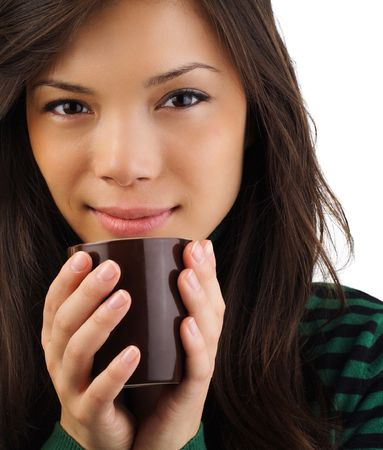 Drinking coffee. Beautiful mixed asian  caucasian woman drinking coffee or tea photo
