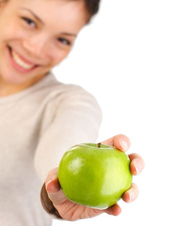 Green apple. Beautiful autumn woman giving you an apple. Isolated on white background. Shallow depth of field, focus on the apple Stock Photo - 5593660