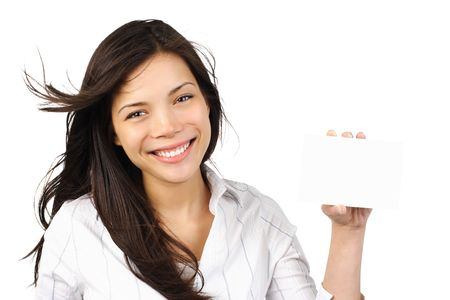 White / empty sign woman.  Beautiful young mixed asian / caucasian woman holding a blank paper card with copy space. Isolated on white background. Stock Photo - 5593665