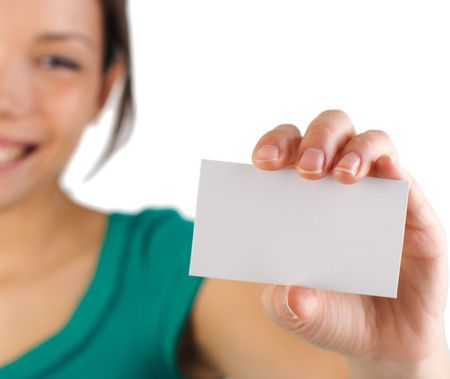 displaying: Business card. Beautiful young woman with big smile displaying a blank business card. Shallow depth of field, focus on card. Isolated on white background