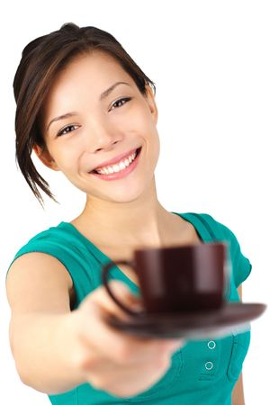 Coffee. Beautiful young woman with big smile serving an espresso. Cup is sharp, model out of focus. Isolated on white. photo