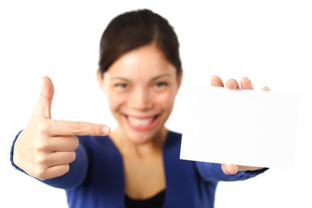 Pointing at blank paper card. very happy excited woman pointing at empty white paper. photo
