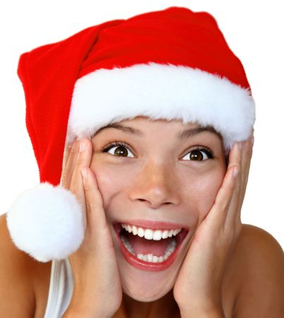 Christmas woman in a Santa hat very surprised and excited. Isolated on white background. photo