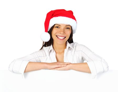 Christmas woman with sign. Very beautiful mixed race asian  caucasian woman with billboard looking at camera. Isolated on white background. photo