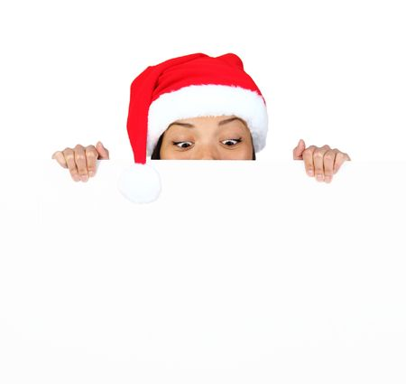 Christmas woman with sign. Very beautiful mixed race asian  caucasian woman with billboard looking surprised down at the sign. Isolated on white background. photo