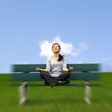 Meditation outdoors. Beautiful mixed asian  caucasian woman. With copy space. photo