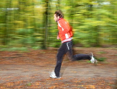 Man running in forest. Motion blurred. Stock Photo